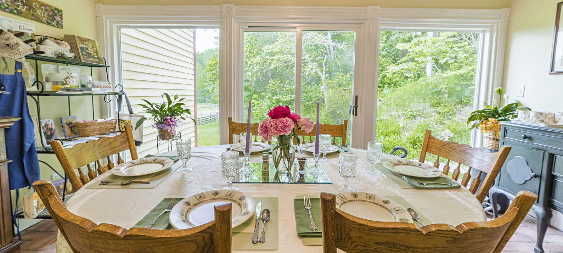 The Sunroom has a complete wall of white-framed windows so you can experience the outdoor seasons as you dine.