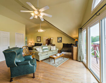 Heron's Nest is a large 700 s.f. suite with green leather recliner and comfortable sofa