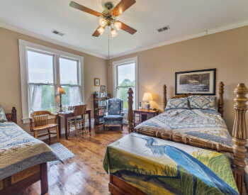 The Otter Creek room has fawn brown walls, one double bed, one twin bed and comfortable chairs and desk.